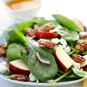 A plate of spinach salad.