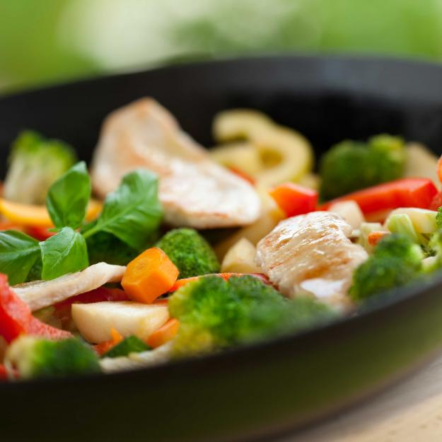 Chicken and vegetables cooking in a pan